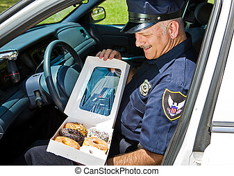 Hungry Policeman - Policeman in his squad car, hungrily...