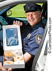 Police Officer - Box of Donuts - Police officer sitting in...