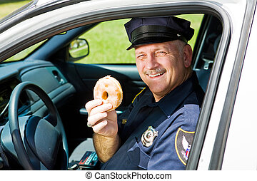 Police Officer and Doughnut - Police officer in his squad...