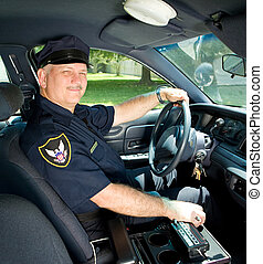 Police Officer Drives Squad Car - Handsome mature police...