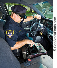 Police Officer With Siren - Police officer using the control...
