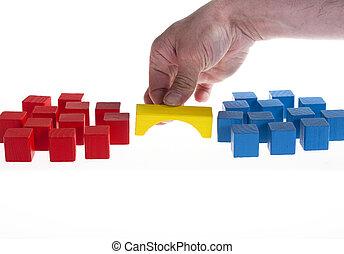Wooden blocks concept: Building a bridge between two groups