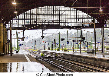 rails and signal lamps in Wiesbaden central train station -...