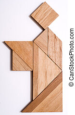 Tangram Puzzle Figure: Serving Man - Serving man built from...