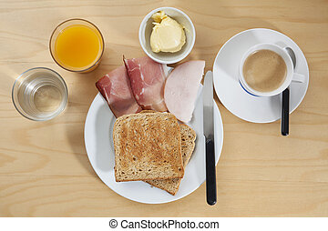 Breakfast with orange juice, coffee, toast