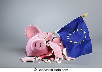 Robbed piggy bank an EU flag - Broken piggy bank with EU...