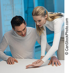 man and woman working with something - picture of man and...