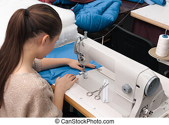 she sews on the sewing machine