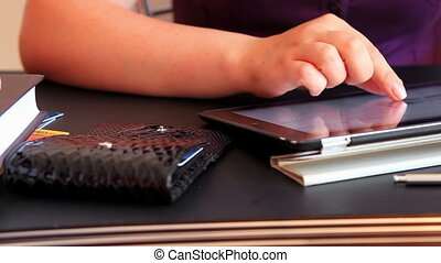 Shopping Online Using Tablet Comput - A young woman shopping...