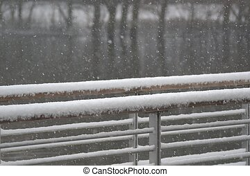 snowcovered handrail - snow covered hand rail on a foot...