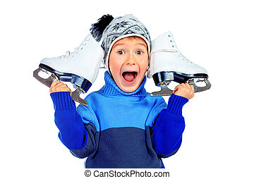 figure skates - Cheerful little boy in warm sweater and hat...
