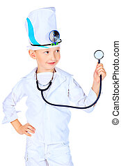 pediatrics - Portrait of a cute boy playing doctor with a...