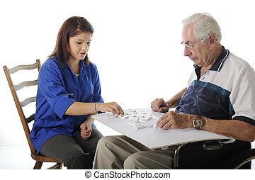 Playing Games with the Elderly - An attractive young...