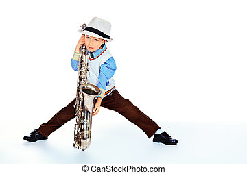 young jazzman - Portrait of a cute little boy jazzman...