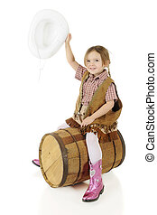 Yahoo! Cowgirl - A happy preschool cowgirl waving her hat as...