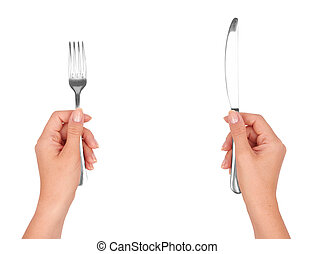 A knife and fork in hands