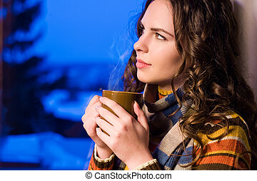 Hot beverage. - Dreamy thoughtful beautiful brunette with...