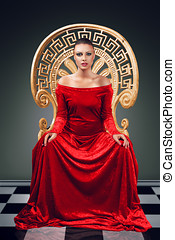 Queen - A woman in a luxurious red dress sitting on a golden...