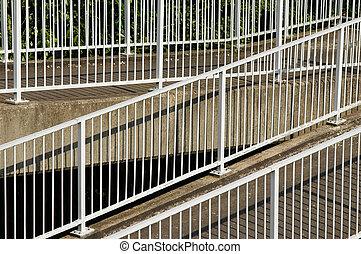 metal railings on a sloping pedestrian footbridge