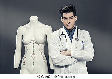 Plastic Surgeon with Dummy - Photo of plastic surgeon with...