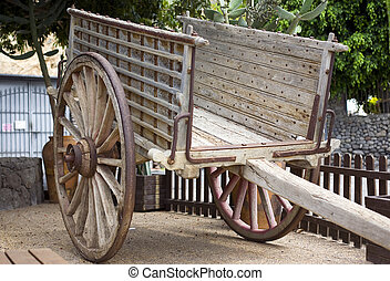 wagon - antique wood cart with big wheels on park