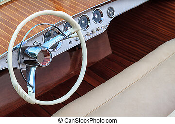 Luxury wooden motor boat - steering wheel and leather seats...
