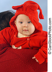 A child dressed in red