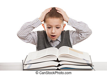 Child reading books - Amazed or surprised child boy reading...