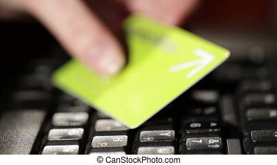 Holding a credit card and typing. - Getting a credit card...