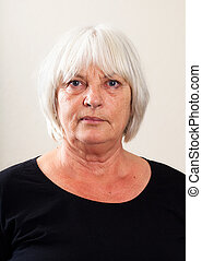 Real People Portrait: Serious Senior Caucasian Woman - Plain...