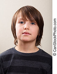 Real People Portrait: Serious Pre-Teen Boy - Close Up...
