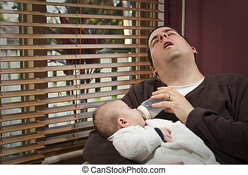 Exhausted father feeds son - An exhausted father feeds young...