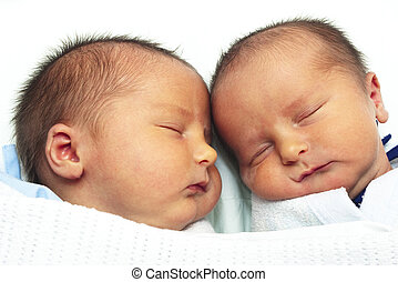 Twin baby boys lying close together