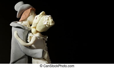 Wedding cake figurines kiss. - Wedding cake figurines are...