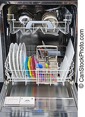 Packed dishwasher of clean dishes - Packed diswahser of...