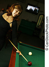 Plays on billiards - The pregnant woman plays on billiards