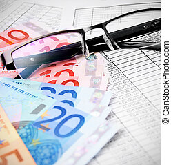 Glasses and euro money. On documents.