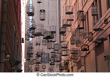Birdcages over Sydney city street - Art installation of...