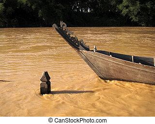 Timber boat at muddy river, Padang Tungku, Malaysia