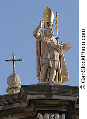 Monument - A statue situated on top of a building