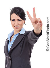 business woman showing victory sign - picture of lovely...