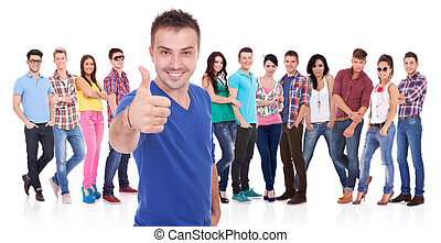 man making the ok thumbs up gesture in front of his firends...