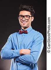 young casual man with glasses smiling