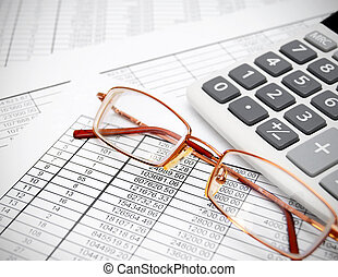 Glasses and the calculator on documents.