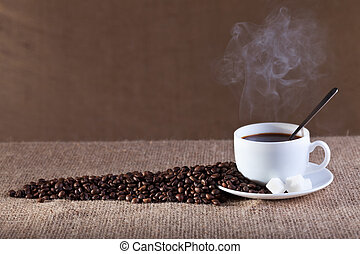 Cup of fresh and hot steaming coffee