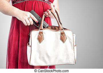 Woman taking gun from purse - White woman in a red dress...