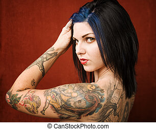Woman with tattoos - Pretty young woman with many tattoos on...