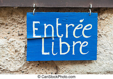 Entree Libre sign in front of store in France