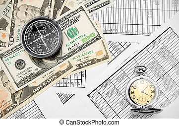Compass , watch and money (dollars). On documents.