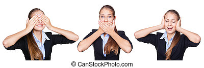 Young businesswoman speak no evil, see no evil and hear no...